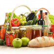 Composition with grocery products in shopping basket — Stock Photo
