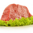 Stock Photo: Composition with piece of beef meat and lettuce
