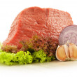 Composition with piece of beef meat and lettuce — Stock Photo