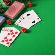 Composition with playing cards on green table — Stock Photo