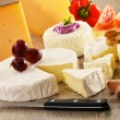 Royalty-Free Stock Photo: Composition with different sorts of cheese on wooden table