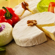 Composition with different sorts of cheese on wooden table — Stok fotoğraf