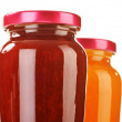 Two jars of fruity jams isolated on white. Preserved fruits — Stock Photo #18008153