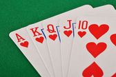 Composition with playing cards on green table — Stok fotoğraf