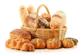 Bread and rolls in wicker basket isolated on white — Stock Photo