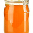 Stock Photo: Jar of honey isolated on white