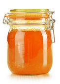 Jar of honey isolated on white — Stock Photo
