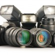 Photo equipment including zoom lenses, camera and flash lights — Stock Photo #19333361