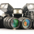 Photo equipment including zoom lenses, camerand flash lights — Stock Photo #19333361