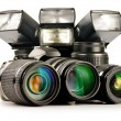 Photo equipment including zoom lenses, camera and flash lights  — Stock Photo