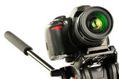 Single-lens reflex camera on tripod isolated on white — Stock Photo