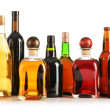 Composition with bottles of assorted alcoholic products isolated - Stock Photo