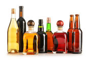Composition with bottles of assorted alcoholic products isolated — Stock Photo