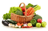 Raw vegetables in wicker basket isolated on white — Stock Photo