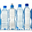 Plastic bottles of mineral water isolated on white — Stock Photo