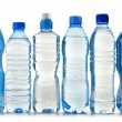 Plastic bottles of mineral water isolated on white — Stock Photo #19716575