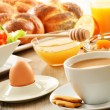 Breakfast including coffee, bread, honey, orange juice, muesli a — Stock Photo #20091571