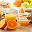 Breakfast including coffee, bread, honey, orange juice, muesli a — Stock Photo #20091733