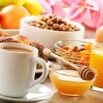 Breakfast including coffee, bread, honey, orange juice, muesli a — Stock Photo #20091885