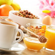 Breakfast including coffee, bread, honey, orange juice, muesli a — Stock Photo #20091947