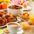 Breakfast including coffee, bread, honey, orange juice, muesli a — Stock Photo #20092181