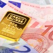 Composition with Euro banknotes and swiss gold bar - Foto Stock