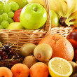 Composition with assorted fruits in wicker basket — Stock Photo #20757711