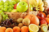Composition with assorted fruits in wicker basket — Stock Photo