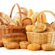 Bread and rolls in wicker basket isolated on white — Stock Photo #20781791