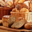 Composition with bread and rolls in wicker basket — Stock Photo #20782087