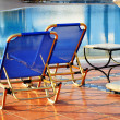 Swimming pool in touristic resort during summer time — Stock Photo