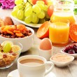 Stock Photo: Breakfast including coffee, bread, honey, orange juice, muesli a