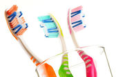 Composition with toothbrushes isolated on white — Stock Photo
