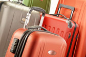 Composition with polycarbonate suitcases — Stock Photo