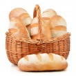 Loafs of bread in wicker basket isolated on white — Stockfoto