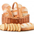 Loafs of bread in wicker basket isolated on white — Stock Photo