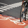 Stock Photo: Bicycle road sign and bike rider