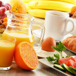 Breakfast with coffee, orange juice, croissant, egg, vegetables — Stock Photo #25901805