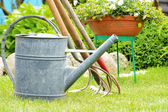 Watering can and garden tools — Photo