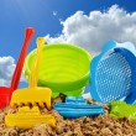 Plastic children toys over the blue sky — Stock Photo #26792131