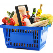 Plastic shopping basket with variety of grocery products — 图库照片