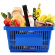 Plastic shopping basket with variety of grocery products — Stock Photo #26805017