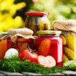 Photo: Jars of pickled vegetables in the garden. Marinated food