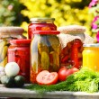 Stok fotoğraf: Jars of pickled vegetables in the garden. Marinated food