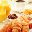 Breakfast with croissants cup of coffee and fruits — Stock Photo #27273933
