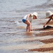 Two little boys playing on the sand beach — Stock Photo