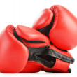 Stock Photo: Pair of red leather boxing gloves isolated on white