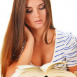 Young woman reading a book. Female student learning — Stock Photo
