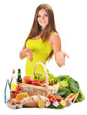 Young woman with assorted grocery products isolated on white — Stock Photo