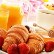 Breakfast with croissants cup of coffee and fruits — Stock Photo #29050681
